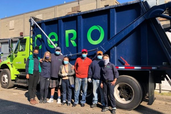 Cero workers in front of one of their trucks