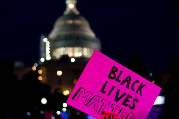 A protestor holds a Black Lives Matter sign during a rally from the White House to the Capitol, July 8, 2016.