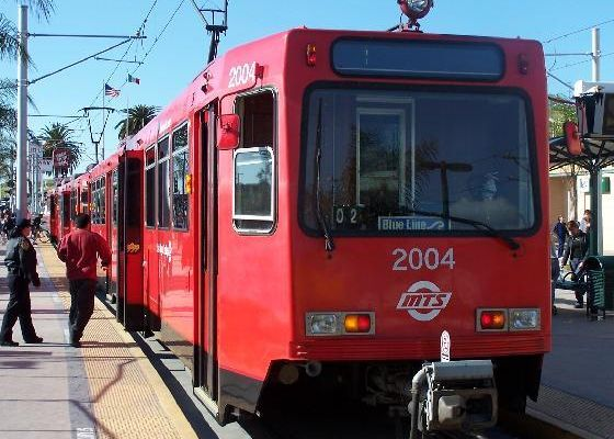 Person boarding a red trolley