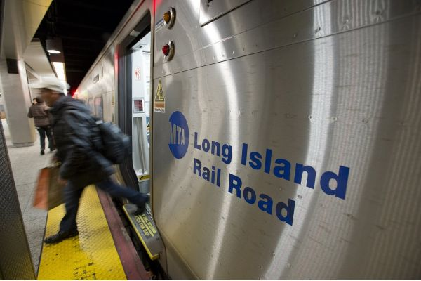 Person exiting a Long Island Railroad commuter train