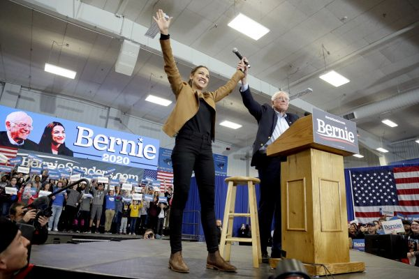 Democratic presidential candidate Sen. Bernie Sanders, I-Vt., and Rep. Alexandria Ocasio-Cortez, D-N.Y., greet supporters on the campus of Iowa Western Community College in Council Bluffs, Iowa, Friday, Nov. 8, 2019.