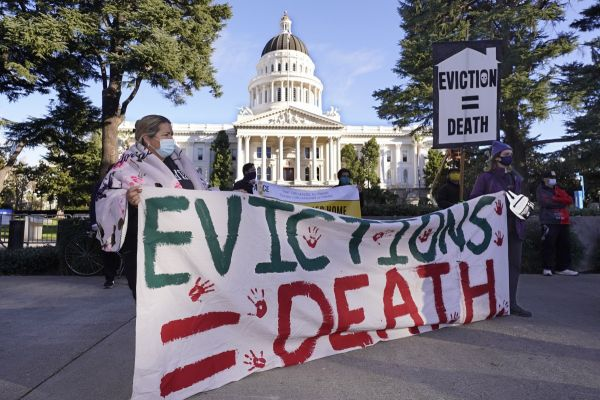 Demonstrators calling for lawmakers and Gov. Gavin Newsom to pass rent forgiveness and stronger eviction protections legislation, gather in front of the Capitol in Sacramento, Calif., on Monday, Jan. 25, 2021.