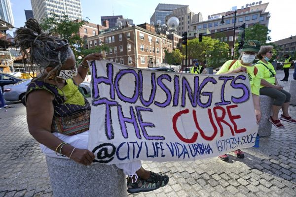 People marching to protest eviction