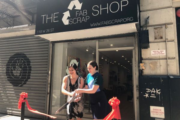 Camille Tagle (left) and Jessica Schreiber (right) cut the ribbon on the new Fabscrap shop, which aims to put a larger dent in New York's textile waste.