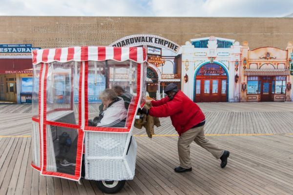 Boardwalk vendors sell rides on Atlantic City's fabling rolling chairs.