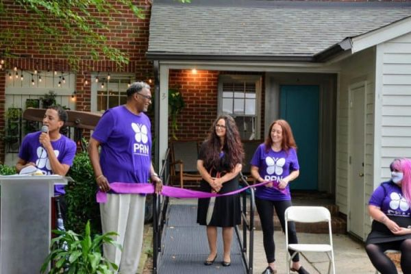 Founder and CEO of Promise Resource Network Cherene Allen-Caraco, center, at the ribbon-cutting ceremony for the mental health agency's peer-run respite.