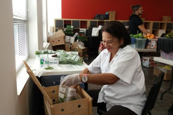 People packing vegetables at the Philadelphia APM food buying club