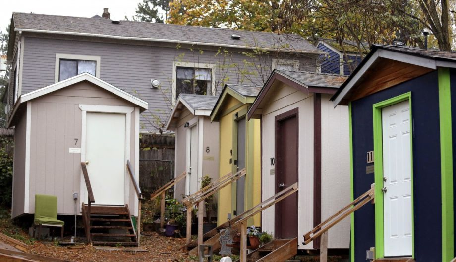 A Row Of Tiny Homes Behind A Conventional House In Seattle. (AP  Photo/Elaine Thompson)