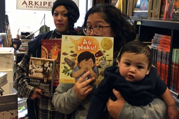 Lily Prijoles (center front) and Golda Sargento, owners of Arkipelago Bookstore (also baby Miles in front).