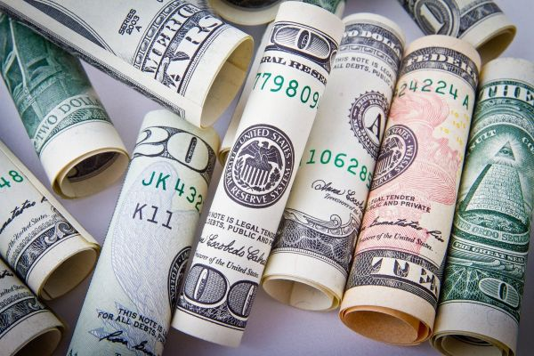 Photo of rolled up dollar bills