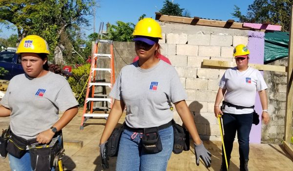 From left: Ana D Burgos Colón, Ashley M Pérez, and Ana H Burgos Colón, women trained and apprenticed by HEART 9/11 to rebuild roofs in Puerto Rico.