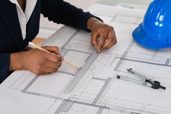 A woman architect working on plans