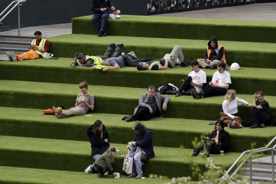 Mapping londons privately owned allegedly public spaces next city people relax as they sit on the green canalside steps off granary square a privately owned public space in london ap photomatt dunham fandeluxe Images