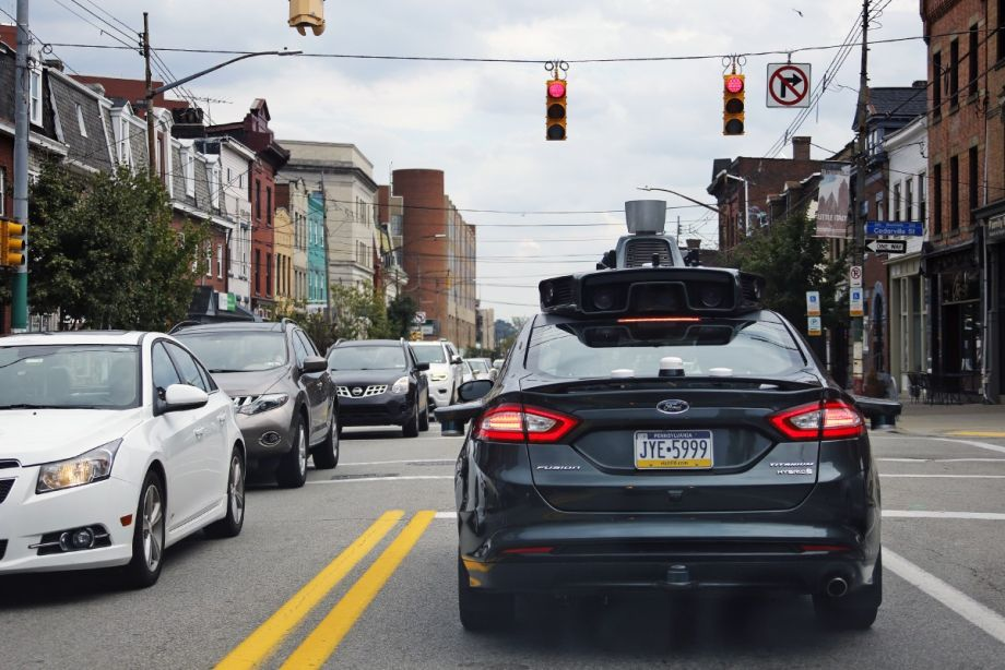 a-self-driving-uber-car-stops-at-a-red-light-on-liberty-avenue-through-the-bloomfield-neighborhood-of-pittsburgh-ap-photo-gene-j-puskar-file